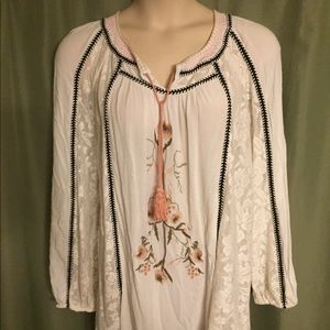 Tops - Baby doll blouse with embroidered flower print.
